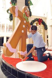 A workman installs decorations at Orlando Fashion Square mall.