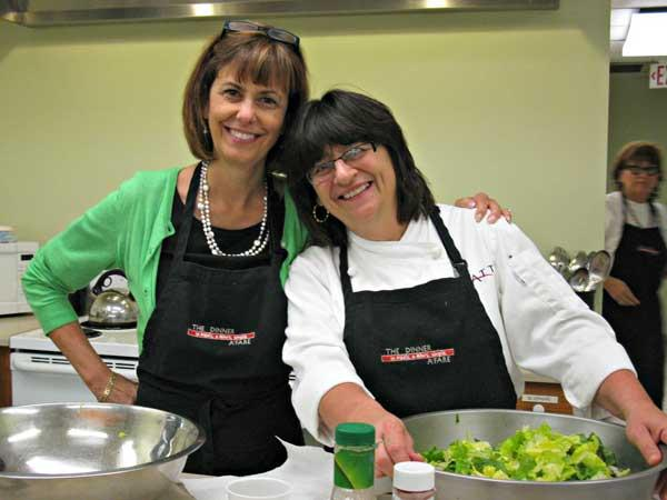 Hyatt Regency General Manager Pat Engfer (left) and cook LouAnn Sepe prepare dinner for Hubbard House, which temporarily houses hospital patients' families.