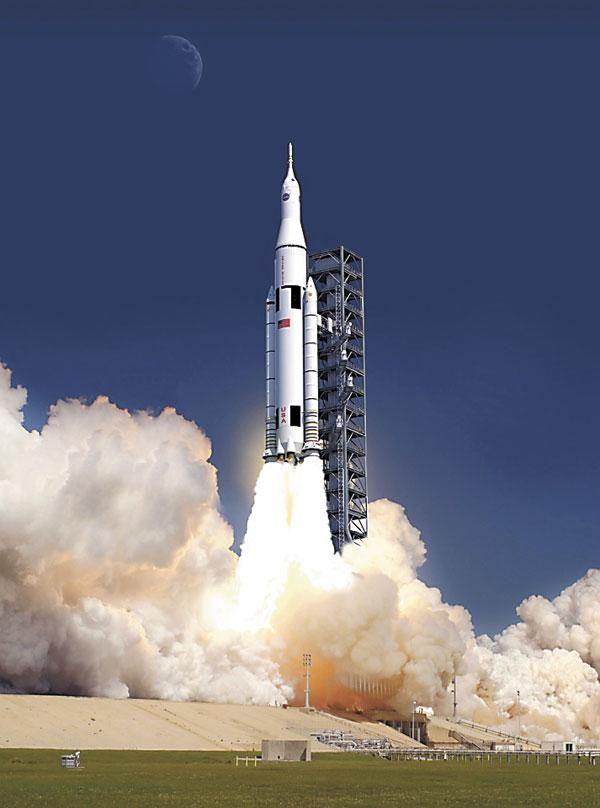 Artist's concept of the liftoff of NASA's new space launch system, which is in development.