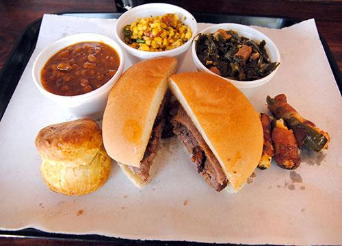 Smoked brisket sandwich and sides from 4 Rivers Smokehouse