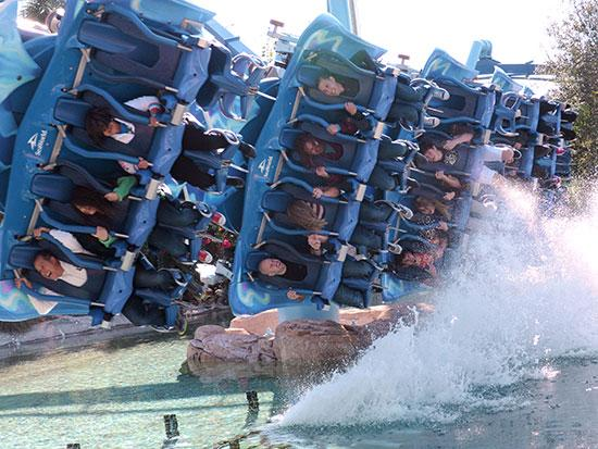 SeaWorld guests react to a diving twist that leads into a water effect on the Manta roller coaster.