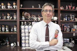 UCF's Paul Jarley loves baseball and even has a bobblehead of himself.