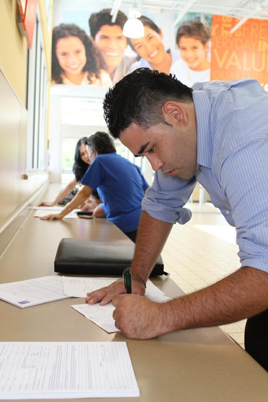 Many employees use job fairs to attract talent. Shown: Chris Losada, 26, at Aldi food market's hiring event on Aug. 21 in Orlando.