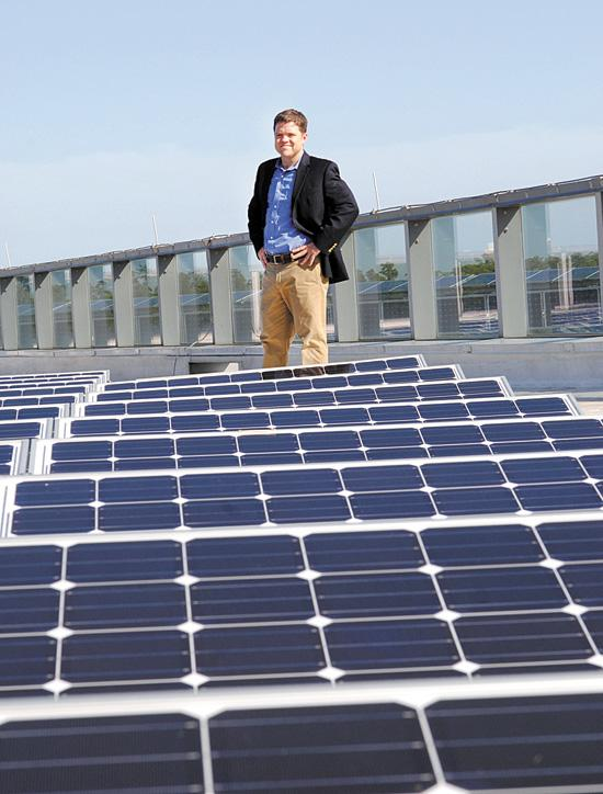 Brandon Tidwell on the Darden headquarters roof where solar panels provide power for building operations