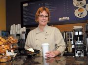 The Hilton Orlando Bonnet Creek and Waldorf Astoria have 100 openings to fill. Shown: Shannon Sell of Muse coffee shop in the Hilton Bonnet Creek