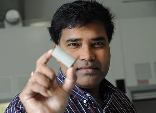 Sudipta Seal, director of the University of Central Florida NanoScience Technology Center, holds a test block that was made from power plant ash.