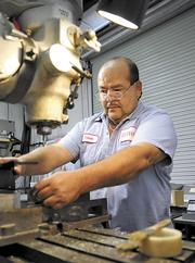 Hernon Manufacturing expects to do more business abroad thanks to the free trade deal. Shown: machinist Edwin Rivera