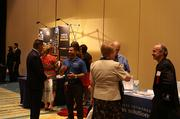 Guests enjoy networking before the start of Golden 100 awards event at the Hilton Orlando.