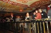 Crowds mingle amid folk art designs at House of Blues.