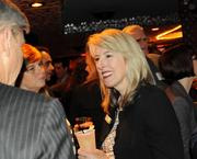 Elizabeth Dvorak of Workscapes Inc. mingles during the party.