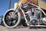 Vintage grey rubber tires adorn a custom bike parked on Main Street during Biketoberfest 2012.