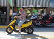 Bikes of all shapes and sizes ride along Main Street during Biketoberfest 2012.