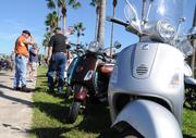 A Vespa display attracts attention on Beach Street during Biketoberfest 2012.