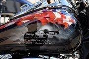 A veteran's memorial adorns a motorcycle parked along Main Street during Biketoberfest 2012.
