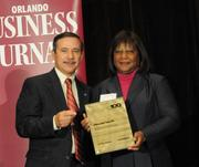 Rosetta Brown accepting the fourth place Ultimate Top 10 award for Boyland Auto Group