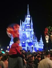 The icicle light display on Cinderella's Castle is the centerpiece to the Magic Kingdom's nighttime holiday display.
