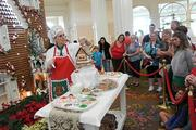 Ellen DiGiovanni, AKA The Gingerbread Lady, gives demonstrations on decorating gingerbread houses at Grand Floridan Resort. DiGiovanni has been in charge of building the Grand Floridian's gingerbread house for 14 years.