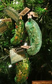 A glass pickle ornament display inside the Die Weihnachts Ecke shop. Heed the warning label, 'cause these aren't edible.