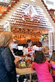 Guests line up to purchase fresh gingerbread treats at the shop window.