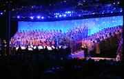 A choir and orchestra accompany the telling of the Christmas story by celebrity guests at Epcot's Candlelight Processional. More than enough to remind Charlie Brown of the true meaning of Christmas.