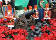 A large scale collection of toys, no doubt left by a giant Santa, sit beneath the Magic Kingdom Christmas tree.