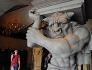 Grotesque statues line the hallways outside Be Our Guest.