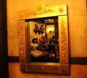 A looking glass transforms into the entrance to an interactive show insideEnchanted Tales with Belle.