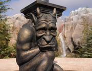 Statues line the pathway to the Be Our Guest restaurant inside Fantasyland's new Enchanted Forest.