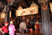 Cast members take orders at the counter insideGaston's Tavern.