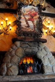 A portrait of Gaston hangs above the mantle in the dining room at Gaston's Tavern.