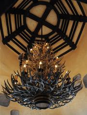 An antler chandelier hangs in a corner of the dining room at Gaston's Tavern.