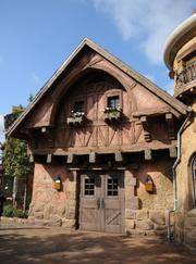 The provincial style of Belle's village is recreated in the Enchanted Forest.