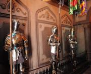 Suits of armor line the armory inside the Be Our Guest restaurant.