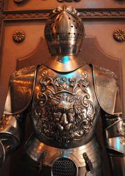 Detail of a suit of armor inside the armory at the Be Our Guest restaurant.