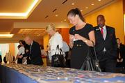 Guests register before the Golden 100 awards event at the Hilton Orlando.