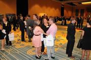 The crowd builds as more guests arrive at the Golden 100 awards event at Hilton Orlando.
