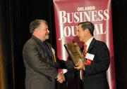 Edward Alden of Greenway Automotive accepts the award for the No. 1 company on the Golden 100 Ultimate Top 10 List.
