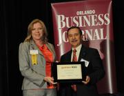 Suzanne Seabolt accepting an Ultimate Newcomer award for Urban Trust Bank