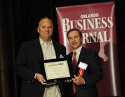 John Flynn accepting an Ultimate Newcomer award for LeCesse Development