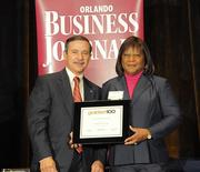 Rosetta Brown accepting an Ultimate Newcomer award for Boyland Auto Group
