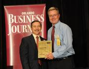 Barry Henderson accepting the fifth place Fast-Track Five award for Wilson & Co Inc.