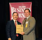 Tim Keating accepting the fourth placeFast-Track Fiveaward for RC Stevens Construction Co.
