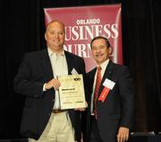 John Flynn accepting the tenth place Ultimate Top 10 award for LeCesse Development