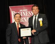 Paul Goldsmith accepting an Ultimate Newcomer award for Core Engineering & Construction Inc.