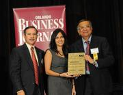 Dr Anjali Vyas and Dr Andy Vyas accepting the ninth place Ultimate Top 10 award for Family Physicians Group