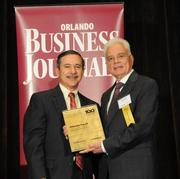Bill Robinson accepting the eighth place Ultimate Top 0 award for Wharton-Smith Inc.