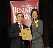 Barbara Latimer accepting the seventh place Ultimate Top 10 award for Sonny's Franchise Co.