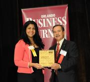Janice Abrew accepting the sixth place Ultimate Top 10 award for Rosen Hotels and Resorts