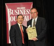 Tim Dolan accepting the fifth place Ultimate Top 10 award for Waste Pro