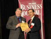 Ted Alden accepting the first place Ultimate Top 10 award for Greenway Automotive